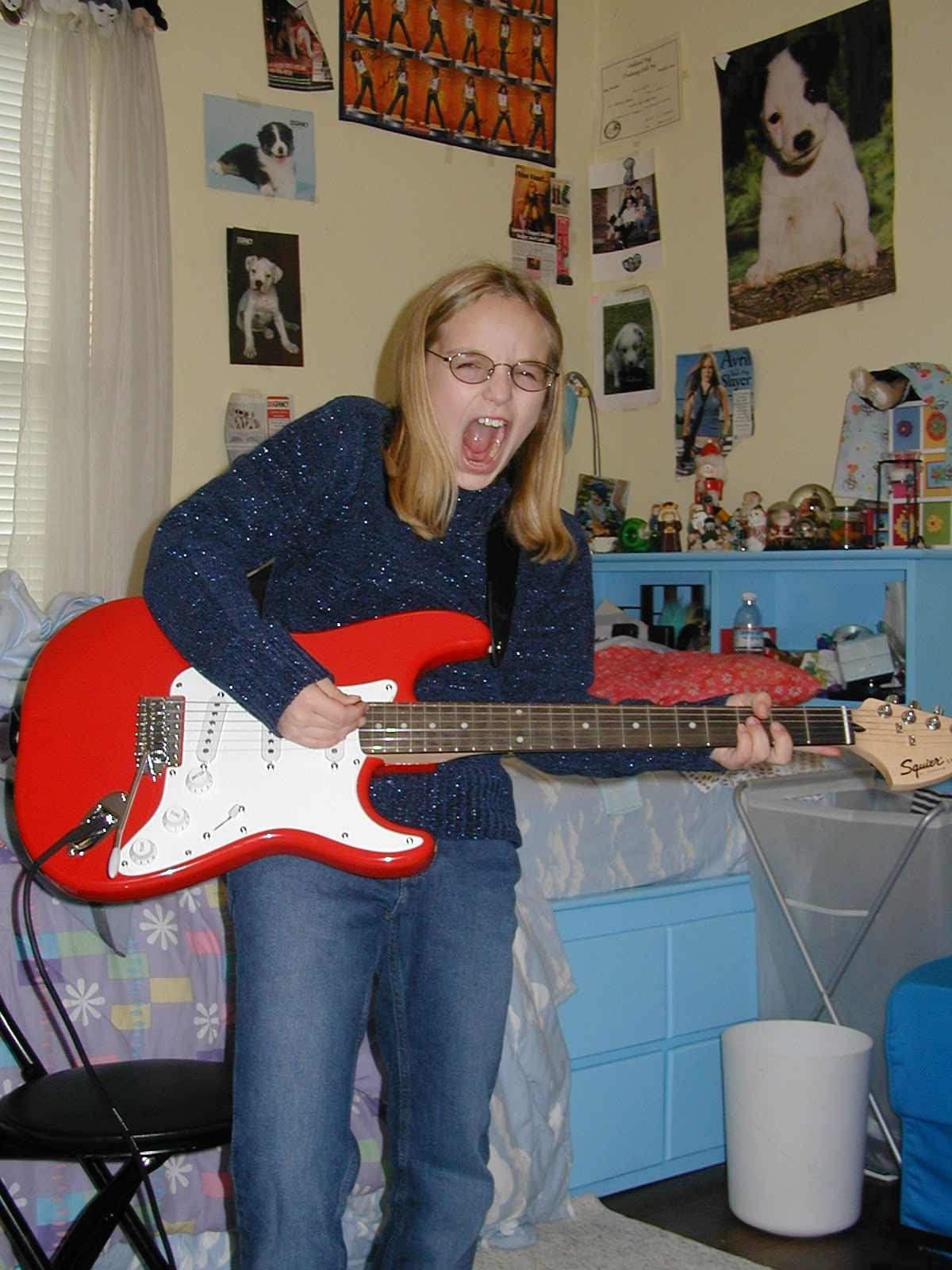 ...and shredding on her brand new electric guitar, Christmas Day 2002.