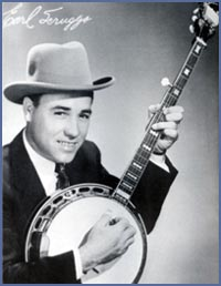 A 1950's era Earl Scruggs promotional picture. Note the box covering the cam tuners on his peg head!